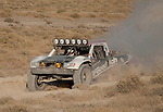 August 19, 2011:  John Swift makes a dust cloud racing through the desert in the Best in the Desert - Las Vegas to Reno Off Road Race on Friday afternoon.  Swift finished 5th overall.