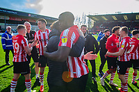 Lincoln City's assistant manager Nicky Cowley hug Lincoln City's John Akinde as they celebrate securing promotion from Sky Bet League Two<br /> <br /> Photographer Chris Vaughan/CameraSport<br /> <br /> The EFL Sky Bet League Two - Lincoln City v Cheltenham Town - Saturday 13th April 2019 - Sincil Bank - Lincoln<br /> <br /> World Copyright &copy; 2019 CameraSport. All rights reserved. 43 Linden Ave. Countesthorpe. Leicester. England. LE8 5PG - Tel: +44 (0) 116 277 4147 - admin@camerasport.com - www.camerasport.com