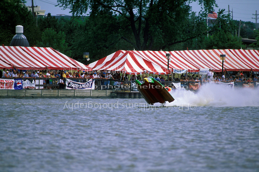 Frame 3: Halfway around the first lap, Wyatt Nelson (#39) blows the boat over crashing back to the water. Nelson was unhurt in the crash. (SST-120 class) Bay City, MI 1998