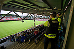 Bangor City 0 FC Honka 1, 23/07/2009. Racecourse Ground, Europa League. A police officer keeps a watch on Bangor City supporters in the main stand at Wrexham's Racecourse Ground, the venue for their sides Europa League second round second leg tie against FC Honka from Finland. The match had to be staged away from City's Farrar Road ground as it did not meet UEFA's stadium standards. The Finns won 1-0 in Wales to go through 3-0 on aggregate in front of 602 spectators in the first season of the newly-introduced competition which replaced the UEFA Cup. Photo by Colin McPherson.