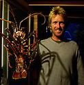 Shaggy with a huge crayfish at a BBQ in Margaret River, Western Australia