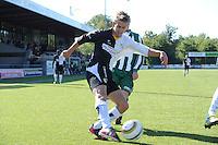 VOETBAL: SNEEK: SWZ Boso Sneek - SC Joure, uitslag 3-2, Tjeerd Andringa (#9) scoorde 2 keer voor SWZ Boso Sneek, in duel met Lennart Nijholt, ©foto Martin de Jong