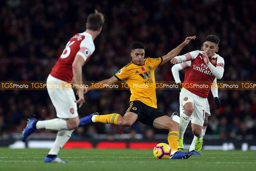 Raul Jimenez of Wolves and Lucas Torreira of Arsenal during Arsenal vs Wolverhampton Wanderers, Premier League Football at the Emirates Stadium on 11th November 2018