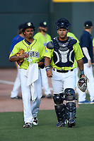 Starting pitcher Harol Gonzalez (45) of the Columbia Fireflies walks toward the dugout with catcher Natanael Ramos (16) before a game against the Augusta GreenJackets on Saturday, July 29, 2017, at Spirit Communications Park in Columbia, South Carolina. Columbia won, 3-0. (Tom Priddy/Four Seam Images)