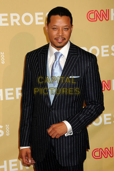 TERRENCE HOWARD.CNN Heroes: An All-Star Tribute 2009 held at the Kodak Theatre, Hollywood, California, USA,.21st November 2009 .half length blue tie pinstripe suit white shirt navy facial hair goatee soul patch .CAP/ADM/BP.©Byron Purvis/AdMedia/Capital Pictures.
