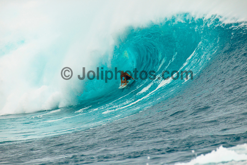 CLOUDBREAK, Tavarua/Fiji (Friday, June 8, 2012) -  Mick Fanning (AUS) riding a surfbaord borrowed from Kala Alexander (HAW) on Filthy Friday. The best day of paddle surfing ever seen at Cloudbreak happen today with the swell in the12'-15' range from the south.  The surf pumped all day with amazing performances from of the world best big wave paddle in surfers. The Volcom Fiji Pro completed the last two heats of Round Two with Bede Durbidge and Kai Otten advancing before being call off for the day. Photo: joliphotos.com