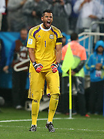 Argentina goalkeeper Sergio Romero celebrates Lionel Messi scoring his penalty during the shootout