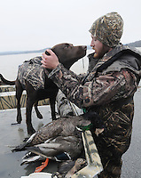 NWA Democrat-Gazette/FLIP PUTTHOFF<br /> Russell Gardner and his retriever, Gunner, celebrate a nice take of ducks after a morning hunt Thursday Jan. 21, 2016 at Beaver Lake. Gardner has had a good season hunting ducks and geese at the lake.
