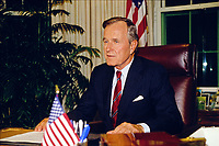 ***FILE PHOTO*** George H.W. Bush Has Passed Away<br /> United States President George H.W. Bush poses for photographers after delivering an address to the nation on the budget compromise in the Oval Office of the White House in Washington, D.C. on October 2, 1990. CAP/MPI/RS<br /> &copy;RS/MPI/Capital Pictures
