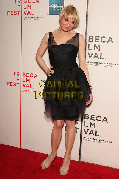 """RENEE ZELLWEGER .attending the 2010 Tribeca Film Festival Premiere of """"My Own Love Song"""" held at the Tribeca Performing Arts Center, New York, NY, USA,  22nd April 2010..full length black dress hand on hip    tulle sheer see thru through straps tiered ruffles layered          beige peep toe platform shoes                        .CAP/LNC/TOM.©LNC/Capital Pictures."""