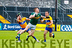 Tommy Walsh Kerry in action against Cian O Dea and Alan Sweeney Clare during the Munster Senior Football Semi Final between Kerry and Clare at Ennis on Saturday night.