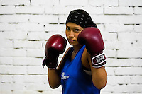 A young Colombian boxer poses for a picture before a sparring session in the boxing gym in Cali, Colombia, 18 April 2013. During the recent years, Kina Malpartida, a Peruvian female professional boxer, has won the World Championship title several times and so she has become a sporting idol and an inspiration for a generation of young girls throughout Latin America. Working out hard in poorly equipped gyms, they dream of becoming a boxing star. The Cauca Valley and the Caribbean coast are believed to be a home of the most talented female boxers in Colombia.