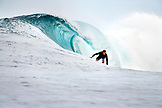 INDONESIA, Mentawai Islands, Kandui Surf Resort, young man surfing on a wave at Bankvaults