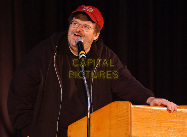"MICHAEL MOORE.visits Carnegie Mellon University on his ""Slacker Uprising Tour 2004"" in the University Center's Wiegand Gymnasium, Pittsburgh, PA, USA, October 26th 2004..half length speaking speech red cap hat.**UK SALES ONLY**.Ref:ADM.www.capitalpictures.com.sales@capitalpictures.com.©JN/AdMedia/Capital Pictures ."