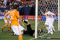 Goalkeeper Jon Conway (18) of the New York Red Bulls makes a save with his leg while on his back. The New York Red Bulls and the Houston Dynamo played to a 1-1 tie during a Major League Soccer match at Giants Stadium in East Rutherford, NJ, on May 16, 2009.