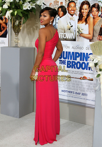 """MEAGAN GOOD .""""Jumping The Broom"""" Los Angeles Premiere Held At The Arclight Cinerama Dome Theatre, Hollywood, California, USA..May 4th, 2011.full length pink red one shoulder dress back behind rear looking over shoulder .CAP/ADM/KB.©Kevan Brooks/AdMedia/Capital Pictures."""