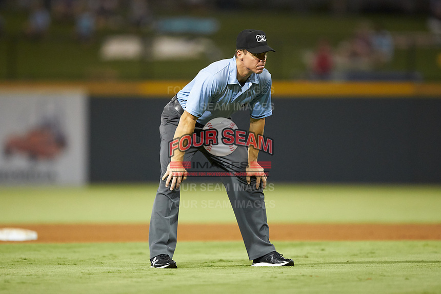 Third base umpire Chris Graham works the International League game between the Scranton/Wilkes-Barre RailRiders and the Gwinnett Stripers at Coolray Field on August 16, 2019 in Lawrenceville, Georgia. The Stripers defeated the RailRiders 5-2. (Brian Westerholt/Four Seam Images)