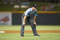 Third base umpire Chris Graham works the International League game between the Scranton/Wilkes-Barre RailRiders and the Gwinnett Stripers at BB&T BallPark on August 16, 2019 in Lawrenceville, Georgia. The Stripers defeated the RailRiders 5-2. (Brian Westerholt/Four Seam Images)