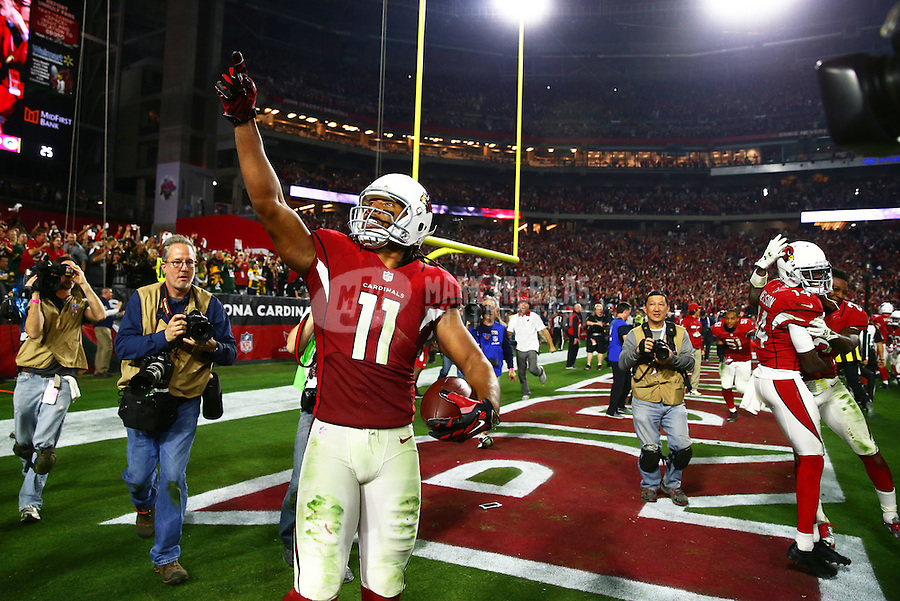 Jan 16, 2016; Glendale, AZ, USA; Arizona Cardinals wide receiver Larry Fitzgerald (11) celebrates after scoring the winning touchdown against the Green Bay Packers during overtime in a NFC Divisional round playoff game at University of Phoenix Stadium. Mandatory Credit: Mark J. Rebilas-USA TODAY Sports