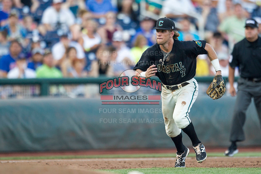 Coastal Carolina Chanticleers third baseman Zach Remillard (7) prepares to field a ground ball against the Florida Gators in Game 4 of the NCAA College World Series on June 19, 2016 at TD Ameritrade Park in Omaha, Nebraska. Coastal Carolina defeated Florida 2-1. (Andrew Woolley/Four Seam Images)