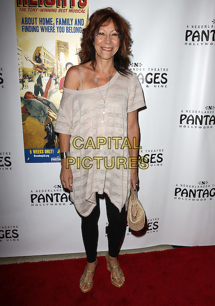 "MINDY STERLING.Broadway Musical Los Angeles premiere Of  ""In the Heights"" held at The Pantages Theatre, Hollywood, CA, USA..June 23rd, 2010.full length top black leggings white grey gray off the shoulder silver necklace glasses smiling .CAP/ADM/KB.©Kevan Brooks/AdMedia/Capital Pictures."