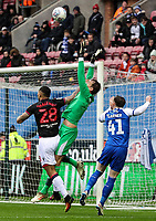 Bolton Wanderers' Josh Magennis competing with Wigan Athletic's goalkeeper Christian Walton <br /> <br /> Photographer Andrew Kearns/CameraSport<br /> <br /> The EFL Sky Bet Championship - Wigan Athletic v Bolton Wanderers - Saturday 16th March 2019 - DW Stadium - Wigan<br /> <br /> World Copyright &copy; 2019 CameraSport. All rights reserved. 43 Linden Ave. Countesthorpe. Leicester. England. LE8 5PG - Tel: +44 (0) 116 277 4147 - admin@camerasport.com - www.camerasport.com