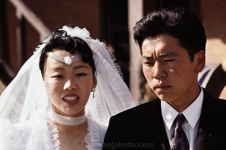 A bride and groom visit a Buddhist monastery in Ulaanbaatar, Mongolia. Marriage. Traditionally, Buddhist monasteries were centers both of learning and of power in Mongolia. In the 1930s, this power became the focus of a ruthless series of purges that reached a climax in 1937. Most of the country's monasteries were destroyed, and as many as 17,000 monks were killed. Monasteries are being restored and are once again crowded with worshipers. Material World Project.