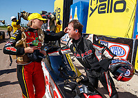 Apr 23, 2017; Baytown, TX, USA; NHRA top fuel driver Leah Pritchett (left) is congratulated by runner up Steve Torrence after winning the Springnationals at Royal Purple Raceway. Mandatory Credit: Mark J. Rebilas-USA TODAY Sports