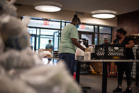 NEW YORK CITY, NY - JUNE 23: Staff member packs food to distribute to needy residents of NYC through emergency food programs on June 23,2020. Food inequality effects 2 million residents in the city , according to a study by Hunger Free America. (Photo by Joana Toro /VIEWpress)