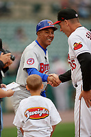 Buffalo Bisons manager Bob Meacham (10) shakes hands with Joel Skinner (35) during the lineup exchange before an International League game against the Rochester Red Wings on May 31, 2019 at Frontier Field in Rochester, New York.  Rochester defeated Buffalo 5-4 in ten innings.  (Mike Janes/Four Seam Images)