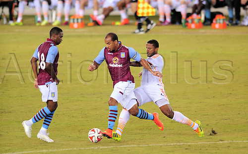 26.07.2014. Houston, Texas, USA.  Aston Villa midfielder Gabriel Agbonlahor is challenged by Jermaine Taylor during 1 - 0 win over the Houston Dynmao  at BBVA Compass Stadium in Houston, TX.
