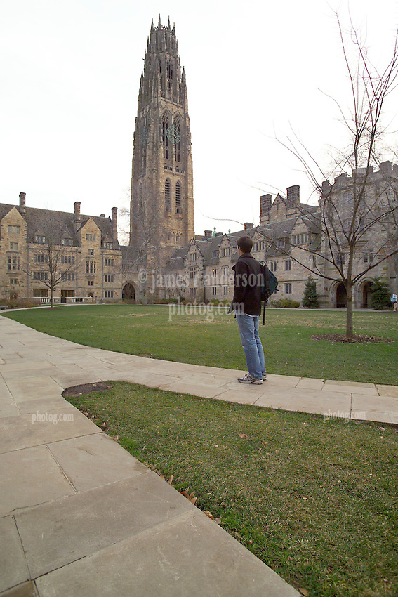 Yale University Campus, The Branford College Quad in Early Winter. Male Student standing facing away from camera.