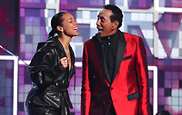 Alicia Keys, left, and Smokey Robinson introduce a tribute to Motown's 60th anniversary at the 61st annual Grammy Awards on Sunday, Feb. 10, 2019, in Los Angeles. (Photo by Matt Sayles/Invision/AP)