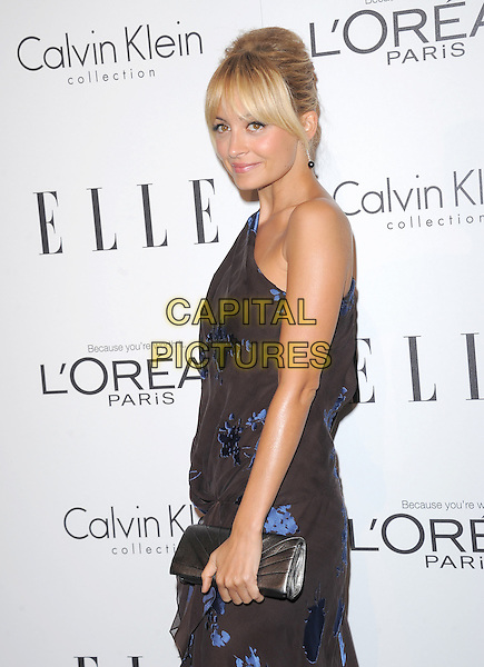Nicole Richie Madden.18th Annual ELLE Women in Hollywood celebration held at The Four Seasons in Beverly Hills, California, USA..October 17th, 2011.half length dress side brown blue print one shoulder floral print fringe bangs hair clutch bag.CAP/RKE/DVS.©DVS/RockinExposures/Capital Pictures.