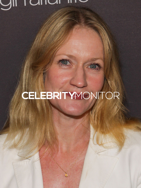 WEST HOLLYWOOD, CA, USA - OCTOBER 22: Paula Malcomson arrives at the Delta Air Lines And Virgin Atlantic Celebratration Of New Direct Route Between LAX And Heathrow Airports held at The London Hotel on October 22, 2014 in West Hollywood, California, United States. (Photo by Rudy Torres/Celebrity Monitor)