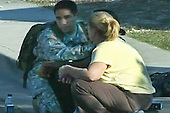 Fort Hood, TX - November 5, 2009 -- A U.S. Army soldier comforts a woman during the deadly shooting on Fort Hood, Texas, Thursday, November 5, 2009. Thirteen people were killed and 30 injured in a rampage..Mandatory Credit: DoD Video Screengrab via CNP