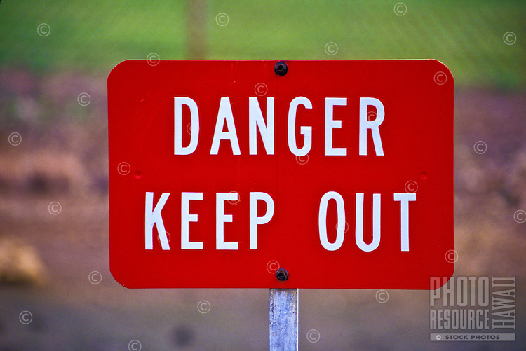 """""Danger Keep Out"""" sign warns beachgoers to stay out of the water because of polluted run off after a heavy rain storm."