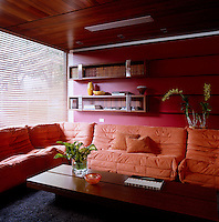 The family room features an orange Togo sofa by Ligne Roset