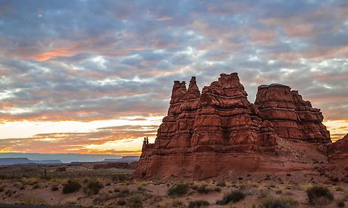 The sun sets in alongside sandstone hoodoos in rural Utah