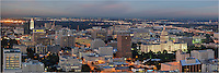 Taken from high above the downtown Austin buildings, this panorama of Austin, Texas shows botht the UT Tower and the Texas State Capitol.