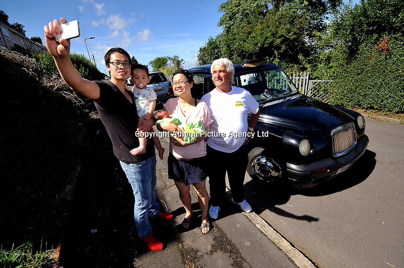 """VIDEO AVAILABLE<br /> Pictured: Time for a selfie...Kai Huang holds his eldest son Tony and his partner Qiuxia Chen who gave birth to their son 'Loeo' in the back of a Swansea taxi cab, pictured with cabby Steve Storton. Baby Loeo was born at 6.45 on Sunday evening  in Sketty, Swansea on their way to hospital.<br /> Re: When taxi driver Stephen Storton embarked on his evening shift, he didn't expect one of his customers to give birth in the back of his car.<br /> But that is exactly what happened when the Data Cabs driver picked up Chinese pair Kai Huang and Quix India.<br /> He said he had never seen anything like it after years working as a taxi driver.<br /> """"It came up on the computer that there was a taxi booked in Townhill for 6.30pm so off I went.<br /> """"When I got there a guy came out and said that his wife was in labor.<br /> """"When I was driving to the hospital she screamed that the baby was coming and that she could feel the head.<br /> """"I then pulled over by the side of Vivian Road in Sketty and the baby was born at 6.45pm.""""<br /> The baby's father Kai Huang described the moment he """"freaked out"""" when his wife Quixia Chen gave birth to their son He said: """"I was really scary, I freaked out.<br /> """"My wife started experiencing some painful contractions so we phoned the hospital and they told us to get her to the hospital immediately.<br /> """"We then phoned a taxi and it arrived within five minutes.<br /> """"The baby came really quickly and half way to the hospital the driver had to pull over as the baby was born before the ambulance arrived.<br /> """"Both mother and baby are healthy now and the baby is called Loeo."""""""