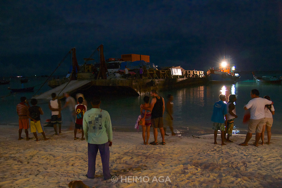Koh Lipe. Arrival of a barge with materials for construction works during hight tide around midnight. The same barge is used for transporting garbage from the island to the mainland.