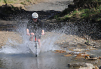 NWA Democrat-Gazette/FLIP PUTTHOFF <br /> A rider splashes across Lee Creek while circling the Fossil Flats Trail April 2 2016 during the 28th annual Ozark Mountain Bike Festival.