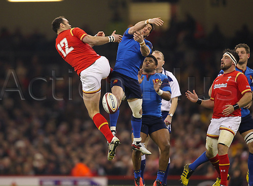 26.02.2016. Principality Stadium, Cardiff, Wales. RBS Six Nations Championships. Wales versus France. Wales Jamie Roberts challenges for a high ball with France's Maxime Machenaud