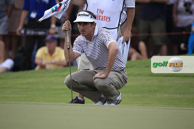 Gonzalo Fernandez-Castano (ESP) lines up his putt on the 18th green during Friday's Round 2 of the season ending DP World Tour Championship 2012 held on the Earth Course at the Jumeirah Golf Estates,Dubai. 23rd November 2012 (Photo Eoin Clarke/www.golffile.ie)