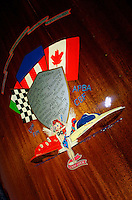 Detail of painting on the deck of an inboard hydroplane naming different builders...