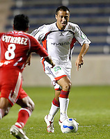 New England Revolution midfielder Jose Cancela (7) prepares to take on Chicago Fire midfielder Diego Gutierrez (8). The Chicago Fire defeated the New England Revolution 2-1 in the quarterfinals of the U.S. Open Cup at Toyota Park in Bridgeview, IL on August 23, 2006...