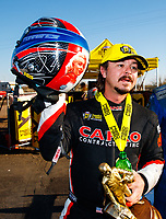 Feb 25, 2018; Chandler, AZ, USA; NHRA top fuel driver Steve Torrence holds his helmet as he celebrates after winning the Arizona Nationals at Wild Horse Pass Motorsports Park. Mandatory Credit: Mark J. Rebilas-USA TODAY Sports
