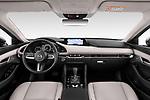 Stock photo of straight dashboard view of 2020 Mazda Mazda3 Skycruise 4 Door Sedan Dashboard