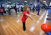 STAFF PHOTO BEN GOFF  @NWABenGoff -- 12/29/14 Georgia Chesser, 5, of Rogers takes a turn bowling while visiting the Rogers Bowling Center with a group from the Rogers Activity Center's Schools Out Day Camp on Monday Dec. 29, 2014 in Rogers. Afternoon field trips are a regular part of the program which provides childcare from 6:30a.m. to 6:30p.m. on most days the Rogers Public Schools are out for holidays.